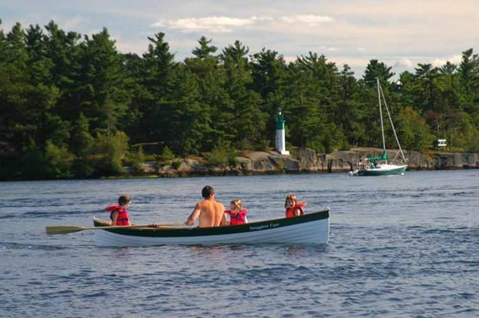 family rowing on lake